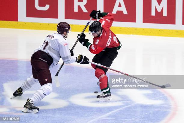 Richard Nedomlel of the Sparta Prague defends against Carl Grundstrom of the Frolunda Gothenburg during the Champions Hockey League Final between...