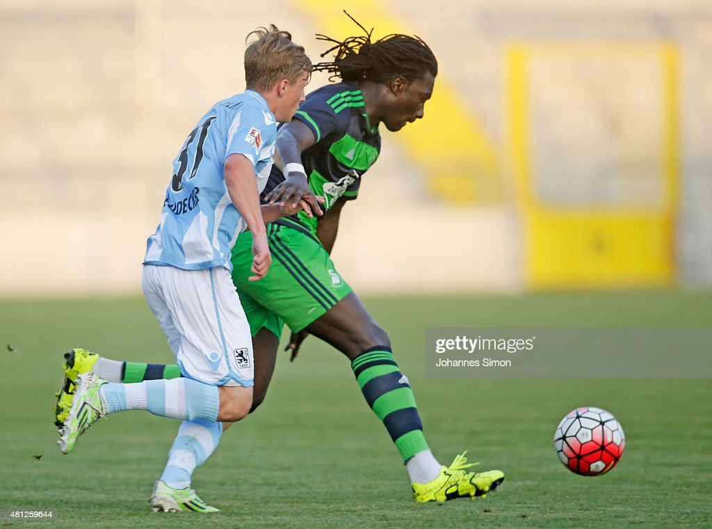 Richard Neudecker of 1860 Muenchen battles for the ball with Bafetimbi Gomis of Swansea during the preseason friendly match between TSV 1860 Muenchen...