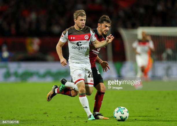 Richard Neudecker of St Pauli und Tim Leibold of Nuernberg battle for the ball during the Second Bundesliga match between 1 FC Nuernberg and FC St...