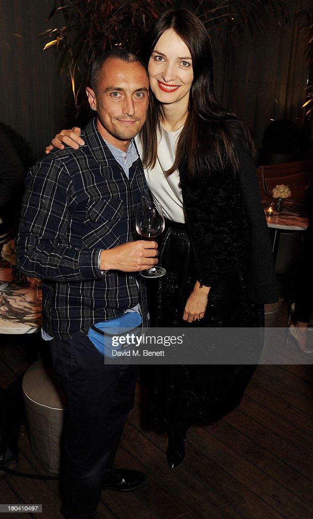 Richard Nicoll (L) and Roksanda Ilincic attend the ELLE Magazine drinks reception celebrating London Fashion Week SS14 at the Sanderson Hotel on September 12, 2013 in London, England.