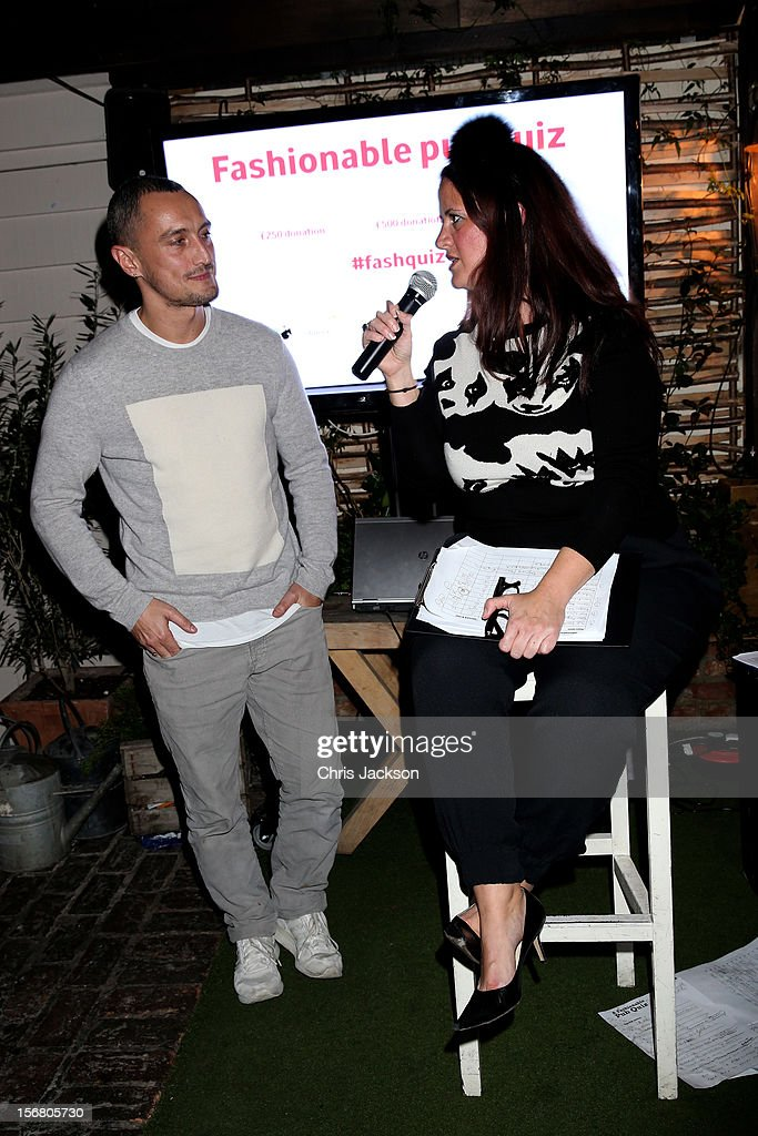 Richard Nicoll speaks with Quizmaster Rebecca Ward hosts the Vodafone Fashionable Pub Quiz at Shoreditch House on November 21, 2012 in London, United Kingdom. As Principal Sponsor of London Fashion Week, the quiz celebrated Vodafone's commitment to British Fashion.