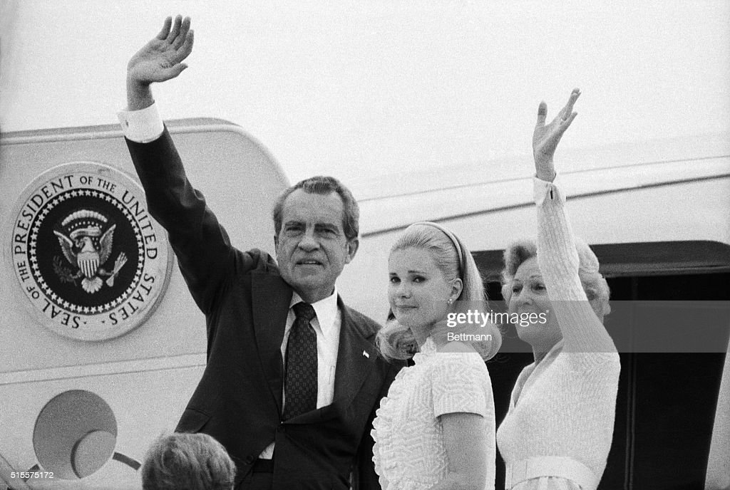 Richard Nixon, his wife Pat and daughter Tricia boarding plane after his resignation. 8/9/1974