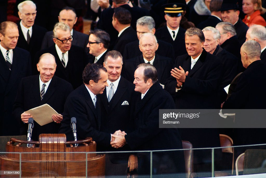 Richard Nixon is greeted by Vice President Hubert Humphrey on arrival January 20th at the Inaugural stand
