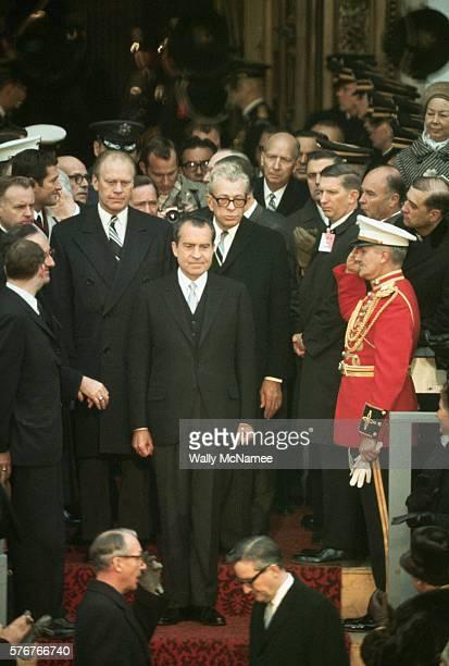 Richard Nixon walks to the inaugural stand escorted by House Minority Leader Gerald Ford and Senator Everett McKinley Dirksen