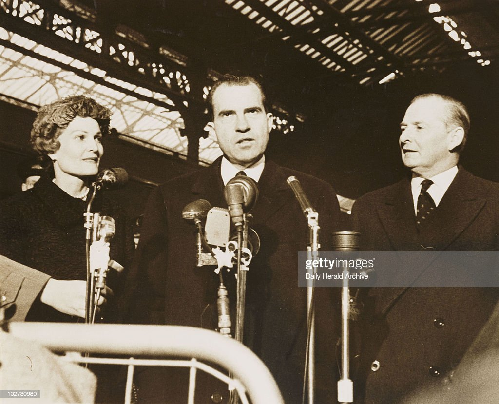 Richard Nixon with his wife and Selwyn Lloyd, London, 1958. A photograph of the American Vice President Richard Nixon (1913-1994), with his wife Patricia and the British Foreign Secretary Selwyn Lloyd, taken by Terry Fincher for the Daily Herald newspaper on 25 November, 1958. Nixon is pictured speaking to journalists at Victoria Station on a visit to Britain. Nixon's plane was unable to land at Heathrow Airport due to fog, so he had been diverted to Gatwick and travelled by train to Victoria. Nixon studied Law at Duke University, serving subsequently as a Navy Lieutenant Commander in the Pacific during World War Two. He was Vice President to General Eisenhower and, after losing to John F Kennedy in 1960, became President in 1969. His Presidency became troubled by the Watergate scandal in 1972 and, faced with impeachment, he resigned in 1974.