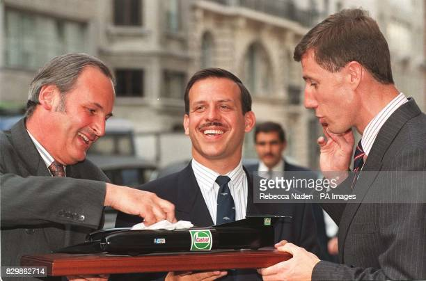 Richard Noble polishes a model of his third Thrust car watched by Prince Feisal of Jordan and Thrust SSC team member RAF Tornado pilot Andy Green...