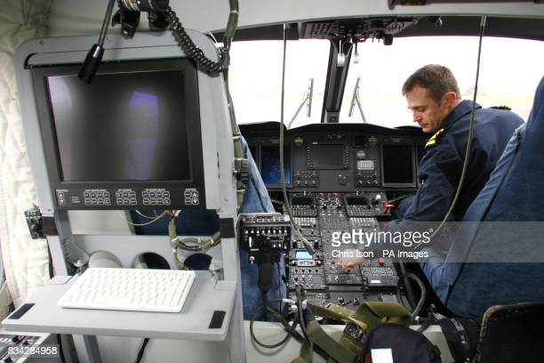 Richard Norris Chief Pilot for The Maritime and Coastguard Agency at the controls of one of their three new search and rescue helicopters at Lee on...
