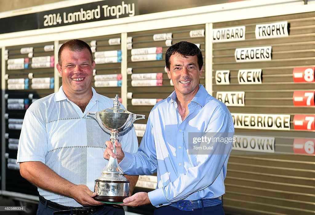 Richard O'Hanlon (R) and Andrew Jones (L) pose for photographs after winning the Lombard Trophy West Regional Qualifier at Burnham and Berrow Golf Club on July 23, 2014 in Burnham-on-Sea, England.