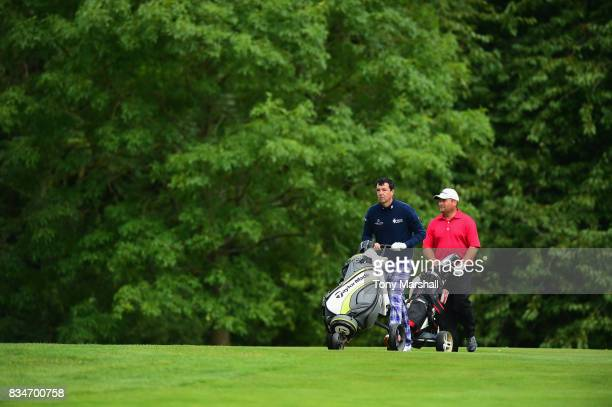 Richard O'Hanlon of St Kew Golf Club and Michael Watson of Wessex Golf Centre walk on the 6th green during the Golfbreakscom PGA Fourball...