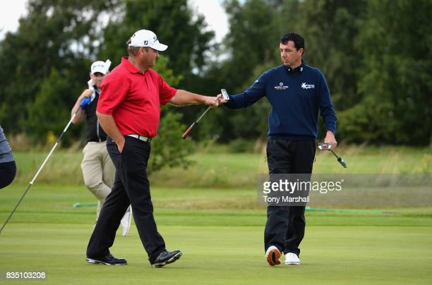 Richard O'Hanlon of St Kew Golf Club and Michael Watson of Wessex Golf Centre celebrate a birdie putt on the 12th green during the Golfbreakscom PGA...