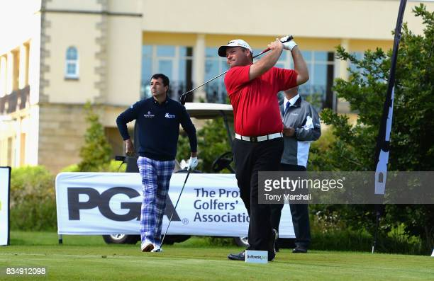 Richard O'Hanlon of St Kew Golf Club watches Michael Watson of Wessex Golf Centre play his first shot on the 1st tee during the Golfbreakscom PGA...