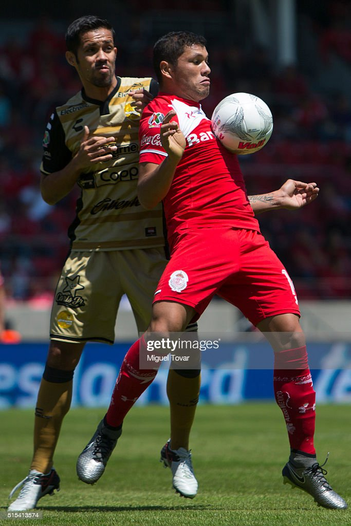 Richard Ortiz of Toluca fights for the ball with Severo Meza of Dorados during the 10th round match between Toluca and Dorados de Sinaloa as part of...