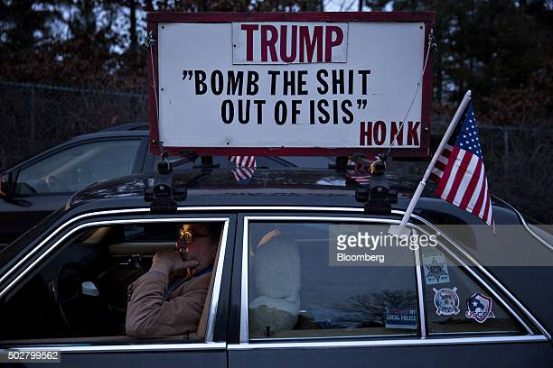 Image contains profanity Richard Ouellette a supporter of 2016 Republican presidential candidate Donald Trump sits in his car at Pennichuck Middle...