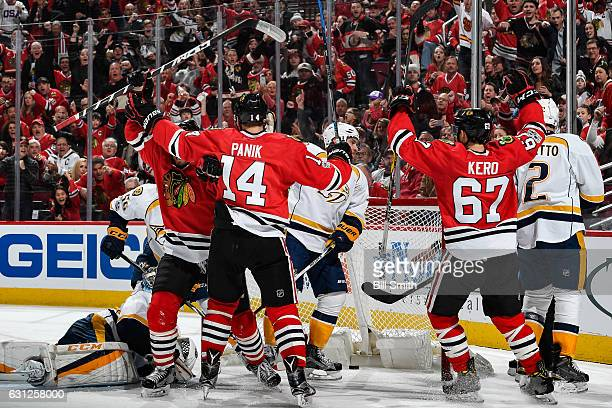 Richard Panik and Tanner Kero of the Chicago Blackhawks react after the Blackhawks scored against the Nashville Predators in the third period at the...