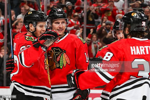 Richard Panik and Tanner Kero of the Chicago Blackhawks react after Kero scored against the Detroit Red Wings in the second period at the United...