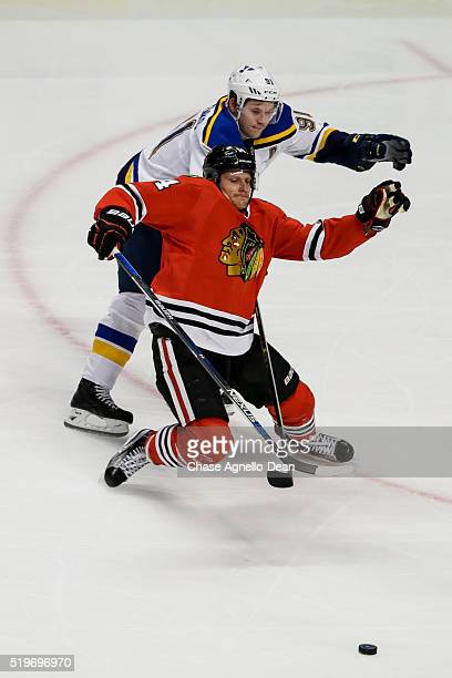 Richard Panik of the Chicago Blackhawks and Vladimir Tarasenko of the St Louis Blues chase the puck in the second period of the NHL game at the...