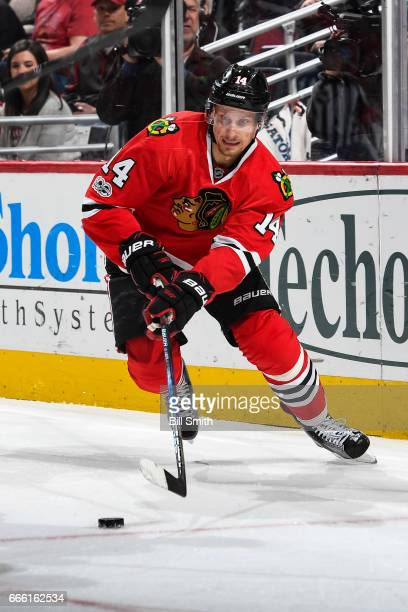 Richard Panik of the Chicago Blackhawks approaches the puck in the first period against the Columbus Blue Jackets at the United Center on March 31...