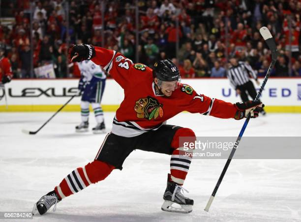 Richard Panik of the Chicago Blackhawks celebrates a third period goal against the Vancouver Canucks at the United Center on March 21 2017 in Chicago...