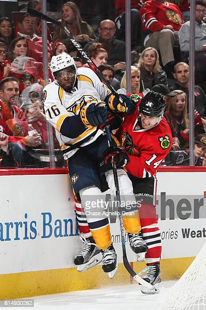 Richard Panik of the Chicago Blackhawks checks PK Subban of the Nashville Predators into the boards in the second period at the United Center on...
