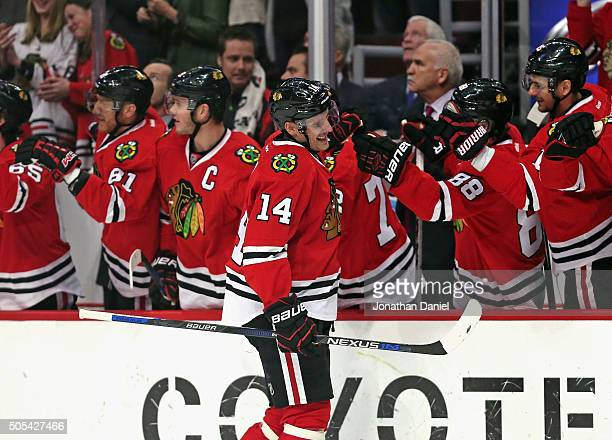 Richard Panik of the Chicago Blackhawks is congratulated by teammates after scroing a first period goal against the Montreal Canadiens at the United...