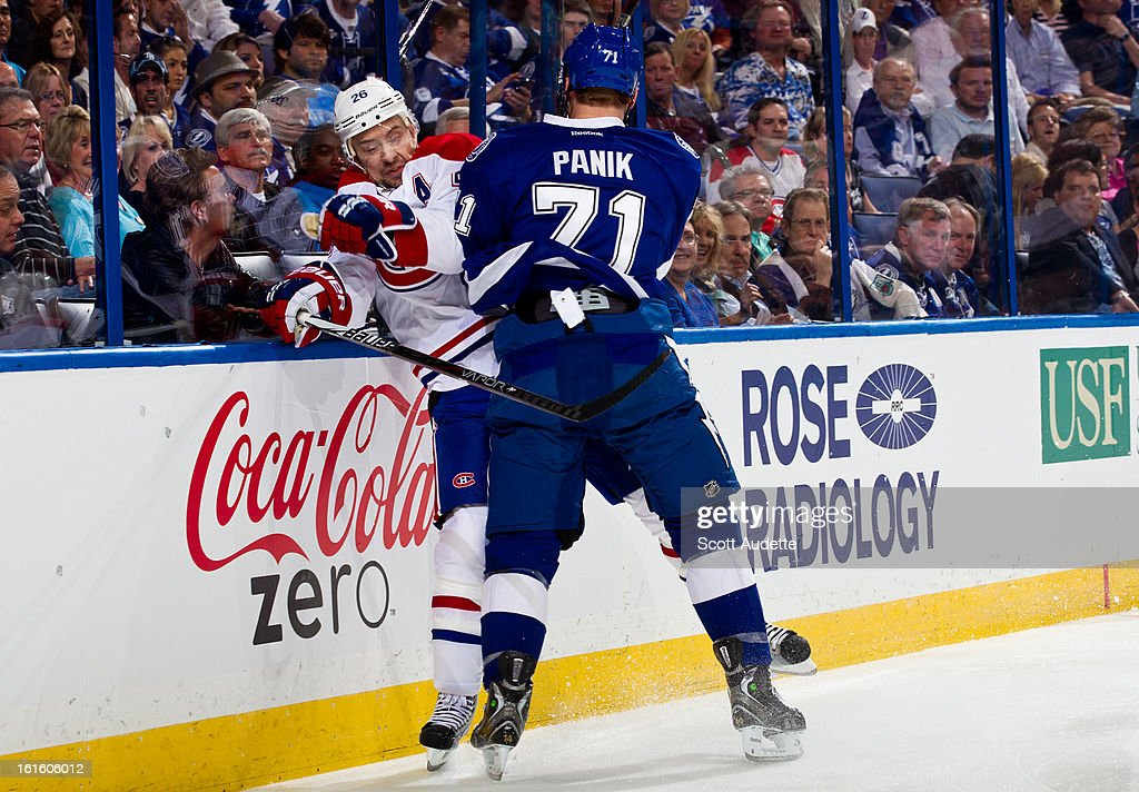 Richard Panik #71 of the Tampa Bay Lightning checks <a gi-track='captionPersonalityLinkClicked' href=/galleries/search?phrase=Josh+Gorges&family=editorial&specificpeople=550446 ng-click='$event.stopPropagation()'>Josh Gorges</a> #26 of the Montreal Canadiens during the first period of the game at the Tampa Bay Times Forum on February 12, 2013 in Tampa, Florida.