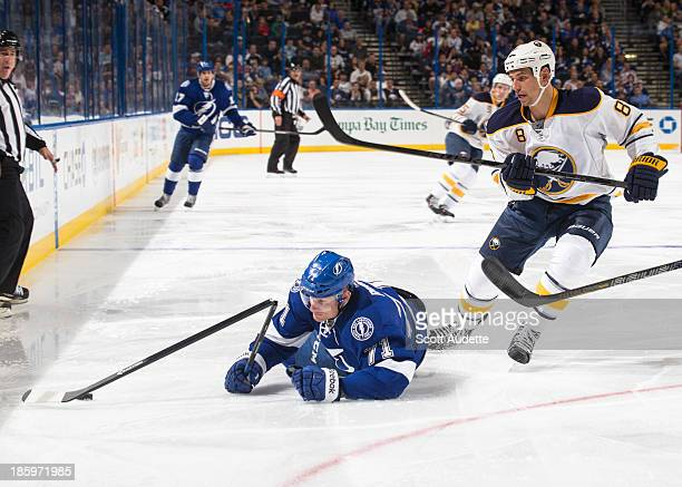 Richard Panik of the Tampa Bay Lightning looks at his broken stick after being cross checked by Cody McCormick of the Buffalo Sabres during the...