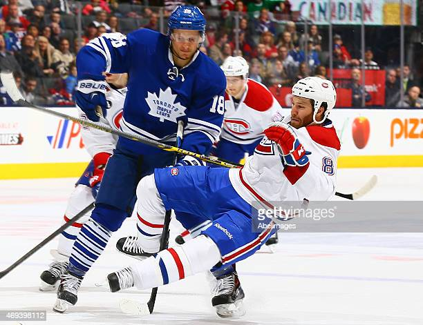 Richard Panik of the Toronto Maple Leafs runs into Brandon Prust of the Montreal Canadiens during NHL action at the Air Canada Centre April 11 2015...