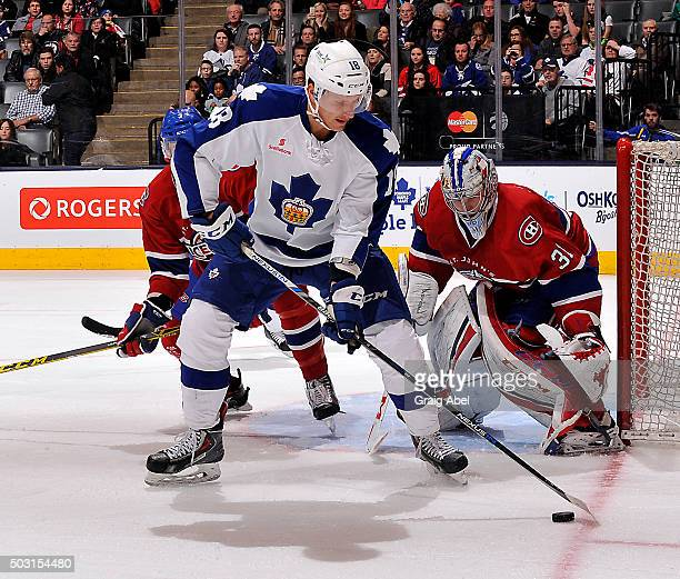Richard Panik of the Toronto Marlies controls the puck in front of goalie Zachary Fucale of the St Johns IceCaps during AHL game action on December...
