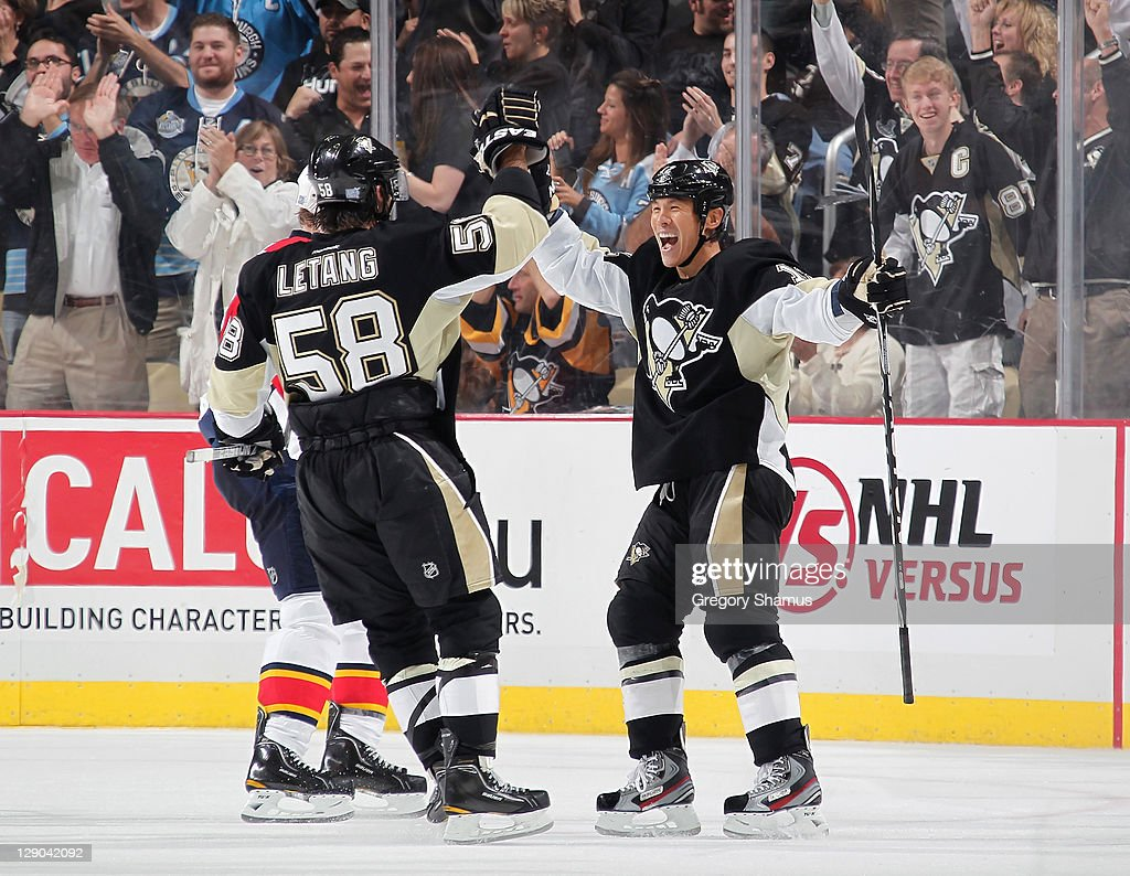 Richard Park of the Pittsburgh Penguins celebrates his goal with teammate Kris Letang against the Florida Panthers on October 11 2010 at Consol...
