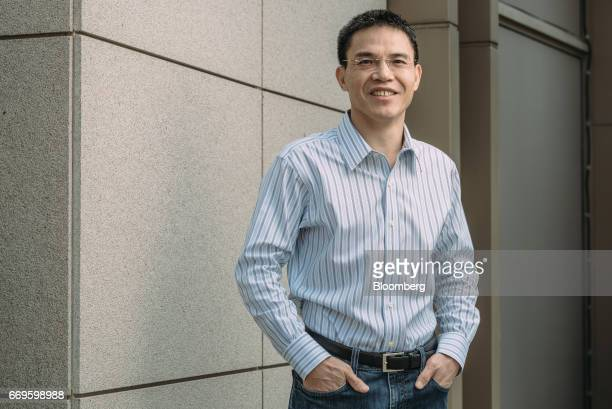 Richard Peng founder of Genesis Capital LLC poses for a photograph in Hong Kong China on Tuesday March 28 2017 Peng's dealmaking moxie set the pace...