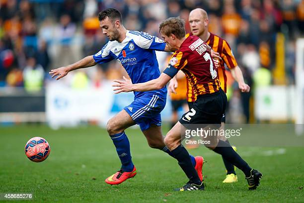 Richard Peniket of Halifax Town is challenged by Stephen Darby of Bradford City during the FA Cup First Round match between FC Halifax and Bradford...