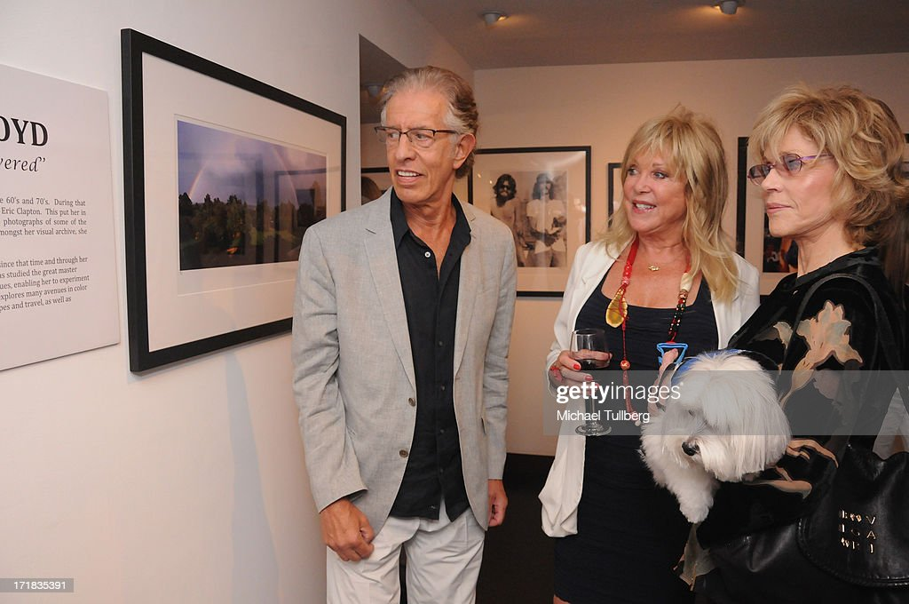 Richard Perry, photographer Pattie Boyd and actress Jane Fonda attend an exhibition of Boyd's photographs entitled 'Pattie Boyd: Newly Discovered' at Morrison Hotel Gallery on June 28, 2013 in West Hollywood, California.