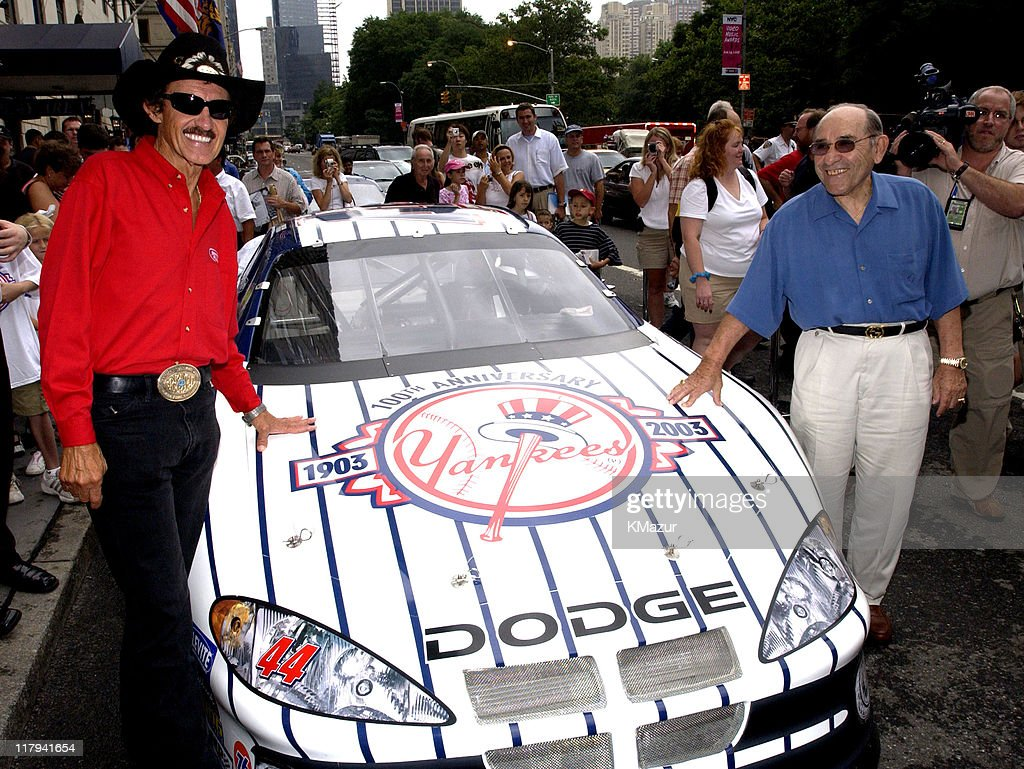 <a gi-track='captionPersonalityLinkClicked' href=/galleries/search?phrase=Richard+Petty&family=editorial&specificpeople=208957 ng-click='$event.stopPropagation()'>Richard Petty</a> and <a gi-track='captionPersonalityLinkClicked' href=/galleries/search?phrase=Yogi+Berra&family=editorial&specificpeople=94270 ng-click='$event.stopPropagation()'>Yogi Berra</a> unveil the #44 Dodge owned by Petty Enterprises, featuring the Yankee Pinstripes and will be driven by <a gi-track='captionPersonalityLinkClicked' href=/galleries/search?phrase=Christian+Fittipaldi&family=editorial&specificpeople=224784 ng-click='$event.stopPropagation()'>Christian Fittipaldi</a> at the Aug. 10, 2003, NASCAR Winston Cup race in Watkins Glen, New York.