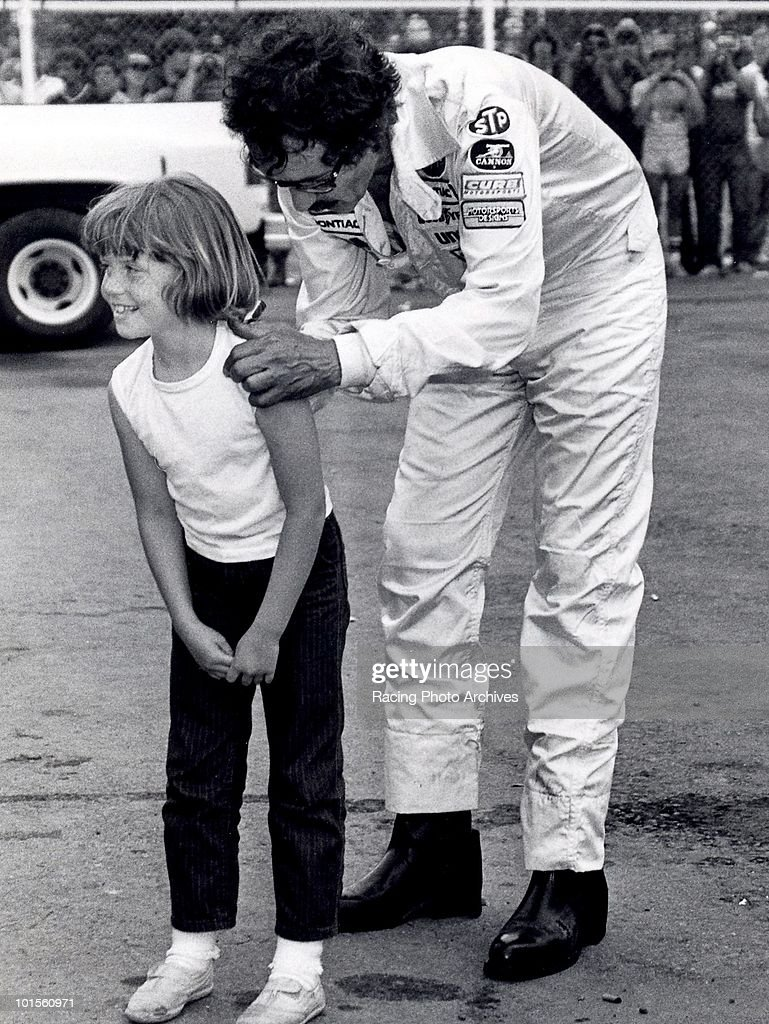 Richard Petty makes a little girl happy after dropping out the Van Scoy Diamond Mine 500 with valve issues. Petty would take home $8,060 for the day.