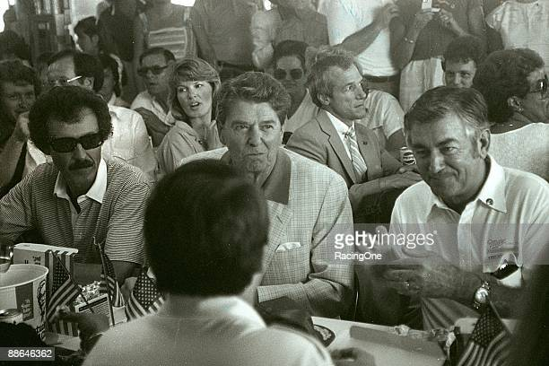 Richard Petty President Ronald Reagan and Bobby Allison at the picnic lunch at the 1984 Firecracker 400 on July 4 1984 at the Daytona International...
