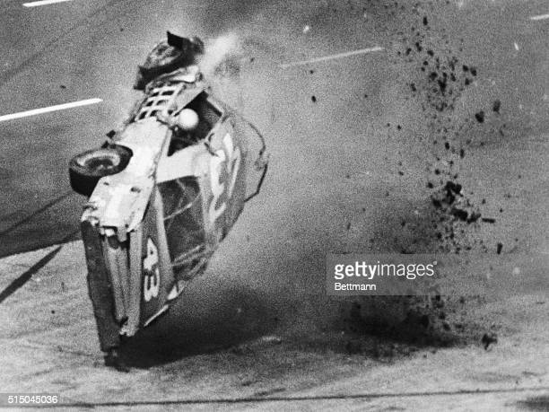 Richard Petty's arm hangs out the window of his Plymouth after the veteran stock car driver hit the retaining wall along the pits and took off on...