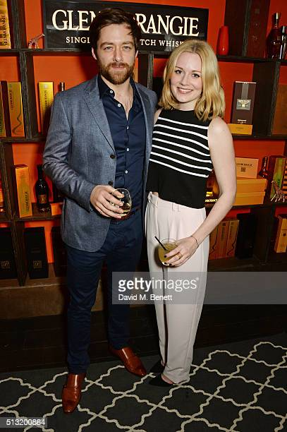 Richard Rankin and Cara Theobold attend the launch of Glenmorangie and Finlay Co collaboration 'Beyond the Cask' on March 1 2016 in London England