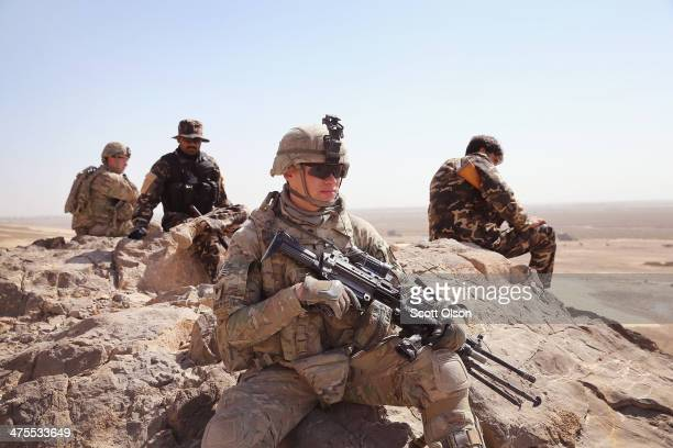 Richard Reilly of Chicago Illinois and other soldiers with the US Army's 4th squadron 2d Cavalry Regiment patrol with police from Afghanistan's...