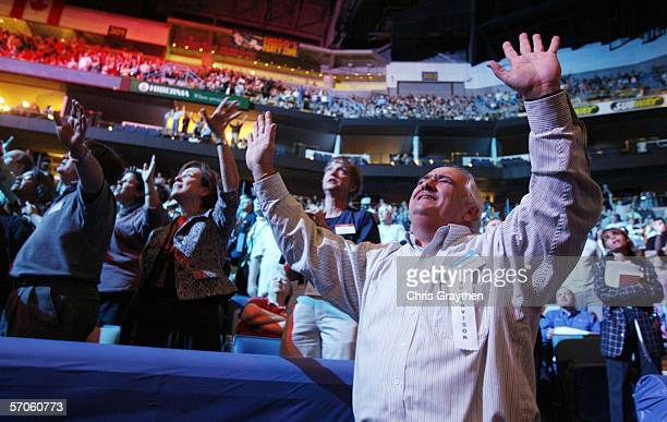 Richard Rigsby prays following Franklin Graham during the Celebration of Hope at the New Orleans Arena on March 11 2006 in New Orleans Louisiana...