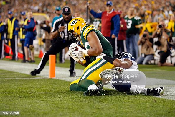 Richard Rodgers of the Green Bay Packers catches a touchdown pass in the fourth quarter against the Seattle Seahawks during their game at Lambeau...