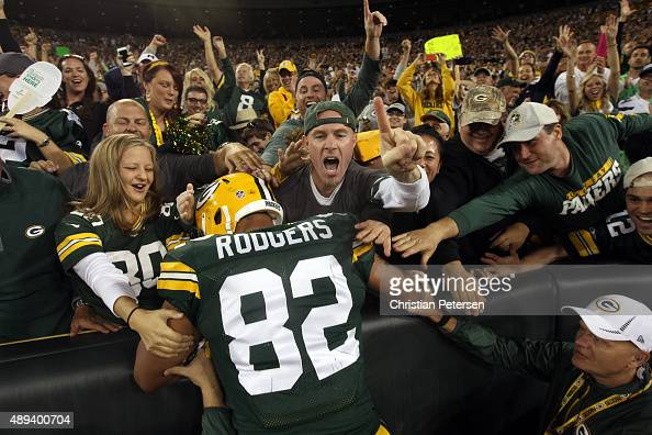 Richard Rodgers of the Green Bay Packers celebrates with fans after scoring a touchdown in the fourth quarter against the Seattle Seahawks during...