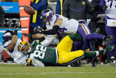 Richard Rodgers of the Green Bay Packers loses the ball as he is tackled by Eric Kendricks and Andrew Sendejo of the Minnesota Vikings during the...