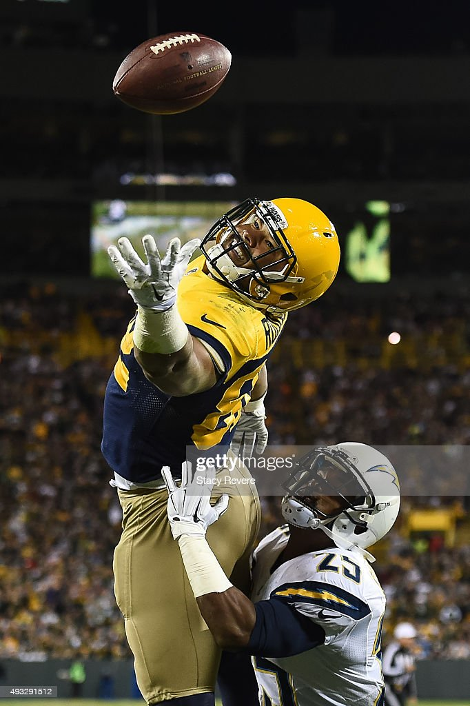 Richard Rodgers #82 of the Green Bay Packers misses the pass while being defended by Darrell Stuckey #25 of the San Diego Chargers in the fourth quarter at Lambeau Field on October 18, 2015 in Green Bay, Wisconsin. The Green Bay Packers defeat the San Diego Chargers 27 - 20.