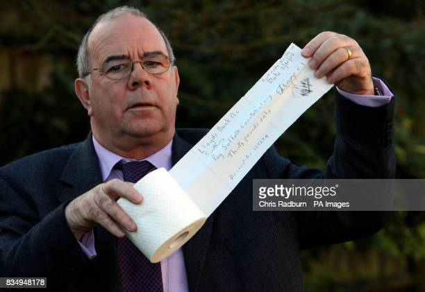 Richard Roper of Long Melford Suffolk shows a mockup of the cheque he wrote out on a piece of toilet paper to pay for a 30 parking fine