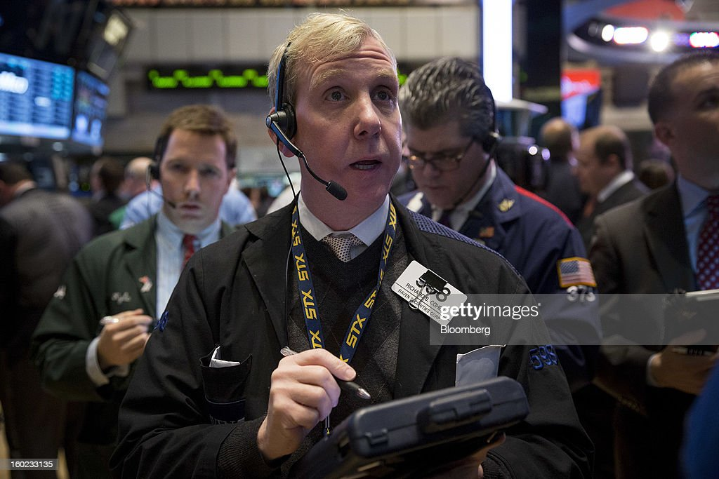 Richard S. Cohen of Raven Securities Corp. works at the New York Stock Exchange (NYSE) in New York, U.S., on Monday, Jan. 28, 2013. U.S. stocks fell, following the longest rally for the Standard & Poor's 500 Index since 2004, after a report showed pending home sales declined. Photographer: Scott Eells/Bloomberg via Getty Images