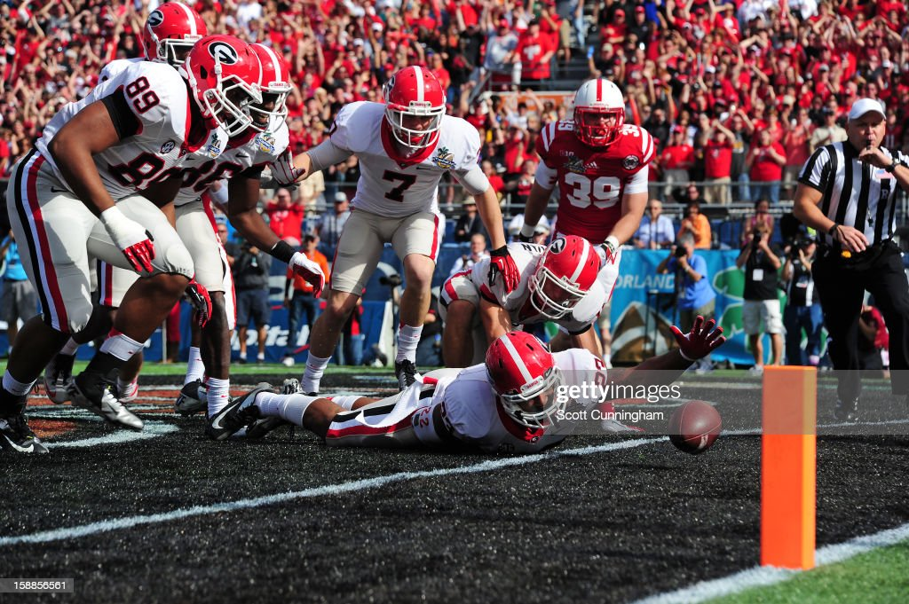 Richard Samuel IV #22 of the Georgia Bulldogs is unable to recover a blocked punt in the end zone against the Nebraska Cornhuskers during the Capital One Bowl at the Citrus Bowl on January 1, 2013 in Orlando, Florida. Georgia would be awarded a safety for a 2-0 lead.