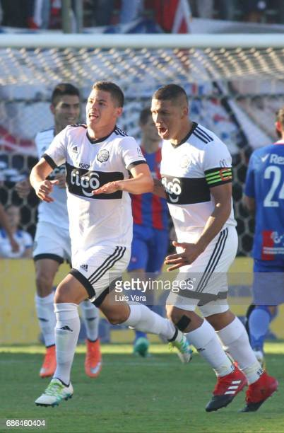 Richard Sanchez celebrates with teammate Richard Ortiz after scoring the first goal of his team during a match between Olimpia and Cerro Porteño as...