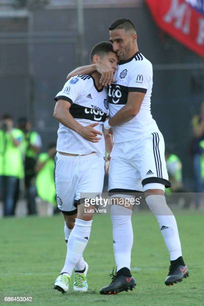 Richard Sanchez of Olimpia celebrates with teammate Hernan Pellerano after scoring the first goal of his team during a match between Olimpia and...
