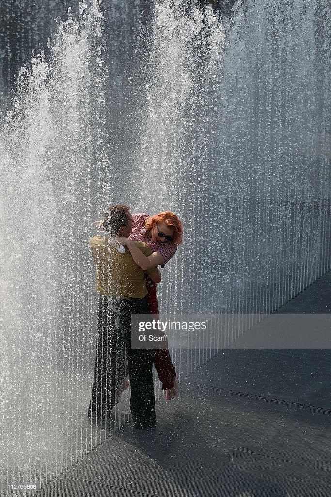 <a gi-track='captionPersonalityLinkClicked' href=/galleries/search?phrase=Richard+Seymour&family=editorial&specificpeople=213798 ng-click='$event.stopPropagation()'>Richard Seymour</a> and Kitten Von Mew dance in a fountain entitled 'Appearing Rooms' by artist Jeppe Hein at the Southbank Centre on April 21, 2011 in London, England. The Southbank Centre is celebrating the 60th anniversary of the Festival of Britain with a roof-top garden, an urban beach, several art installations and a row of beach huts. The festival will officially open to the public from tomorrow and run until September 9, 2011.