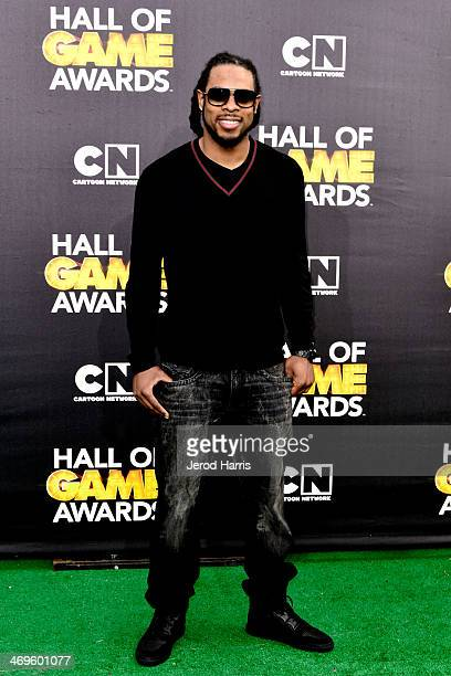 Richard Sherman arrives at the 4th Annual Cartoon Network Hall Oof Game Awards at Barker Hangar on February 15 2014 in Santa Monica California
